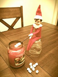 Elf on the shelf ideas. This mom even created a facebook page for their elf. Lots of cute pics. This one is hilarious to me for some reason.: