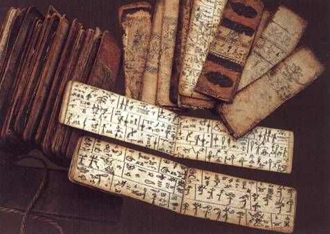 Books in Donga hieroglyphics. Dongba refers to the religious priests, the culture, and script of the Nakhi people, who are found in southwestern China.