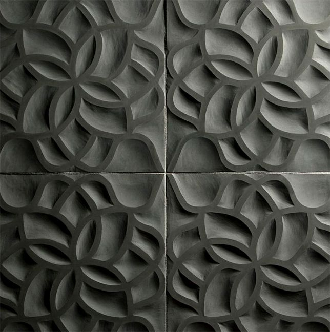 Natural stone from Artistic Tile is carved in relief to create this botanical design great for the bath , kitchen or fireplace wall.