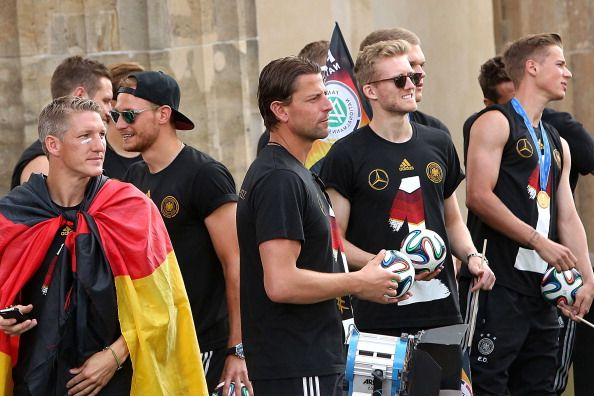 (Front L-R) Germany's midfielder Bastian Schweinsteiger, defender Shkodran Mustafi, goalkeeper Roman Weidenfeller, midfielder Andre Schuerrle and defender Erik Durm look ahead as they arrive for a victory parade of Germany's football national team on July 15, 2014 at Berlin's landmark Brandenburg Gate to celebrate their FIFA World Cup title. Germany won their fourth World Cup title, after 1-0 win over Argentina on July 13, 2014 in Rio de Janeiro in the FIFA World Cup Brazil final game.
