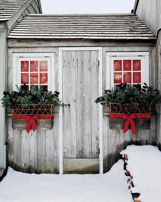 Love the outdoor window boxes each dressed up with a red bow!