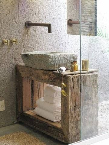 Old wood and rough stone lend a beautiful look to this small bathroom.