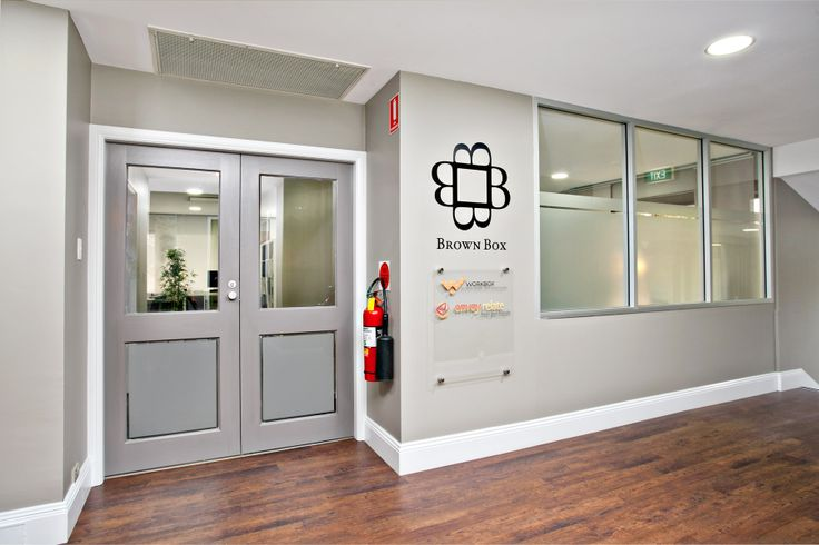 Brown Box offices, including sign design, floor, walls removed, walls built, boardroom, office space design.