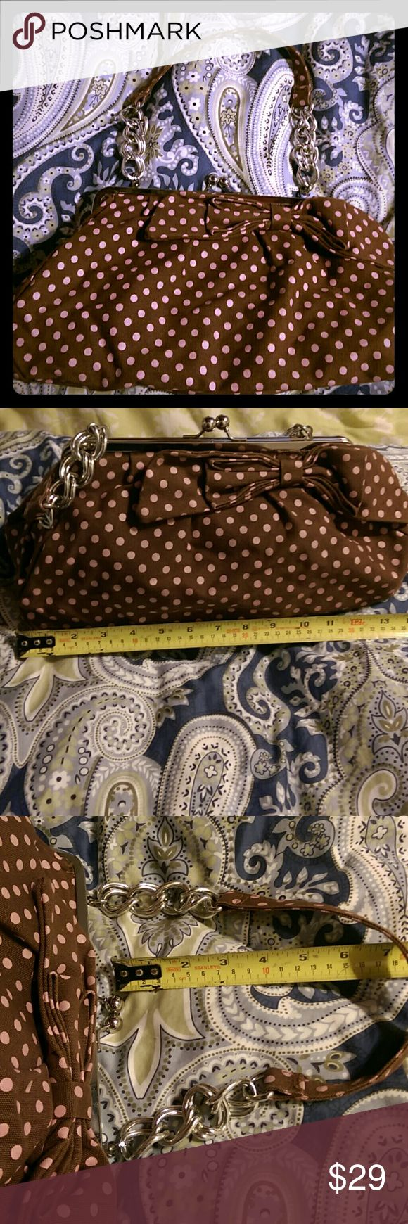 "Delia's Vintage Canvas Purse Delia's vintage! Bow front, pink and brown polka dots, silvertone hardware. Canvas exterior, brown lined interior with 2 slip pockets and a zipper pocket. Really hold quite a lot! Main clasp is pictured like a coin purse. Dimensions: 9"" drop from handles. 14"" wide, 7"" tall, 5.5"" deep at base. Got so many compliments when I used to carry this. Bags Satchels"