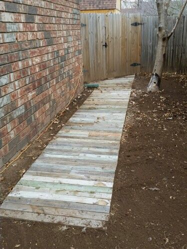 Reclaimed wood walkway using old 2x4's or pallets. Perfect