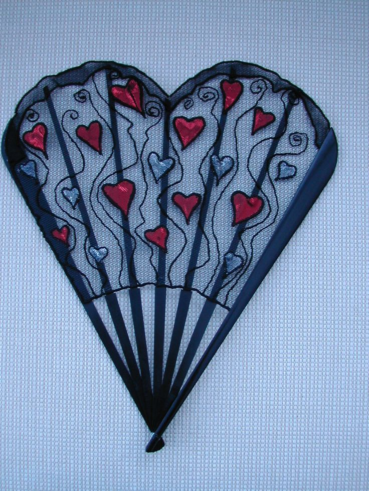 Dancing hearts. Machine embroidered and appliqued net on antique black wood sticks, - made for Valentine's day