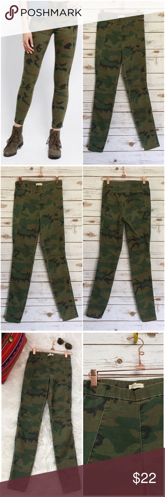 """Silence + Noise Camo Pull-On Skinny Pants Stretchy, fitted skinny pant from Silence + Noise with a banded elastic, pull-on waist. Topped with an allover camouflage print.  Ankle length.  Condition: In good preloved condition. Minimal wear. No holes, stains or damage. Pet free and smoke free.  Fabric: Cotton, polyester, spandex.  Machine wash.  Imported.  Approximate Measurements: Waist: 12"""" Across (Total 24"""") Inseam: 29"""" (L)   Front Rise: 8.5 (L)  Back Rise: 11 (L) Leg Opening: 4.75"""" flat…"""