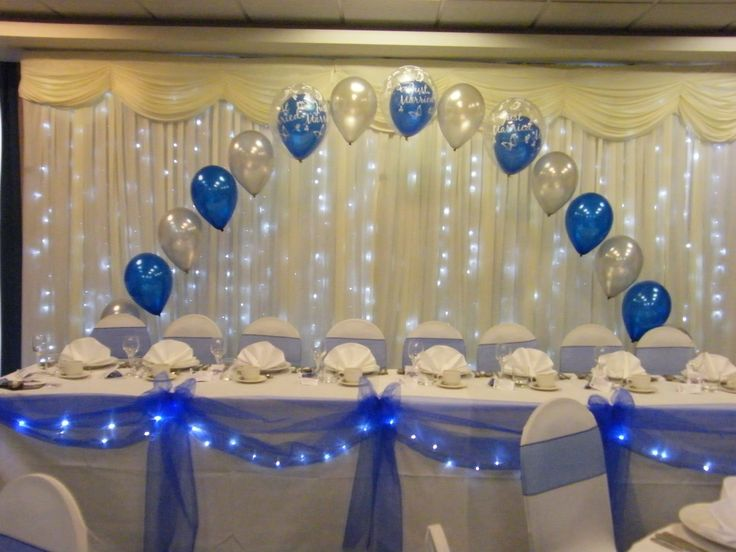 Wedding Top table arch, swags and bows with lights and chair covers royal blue and silver