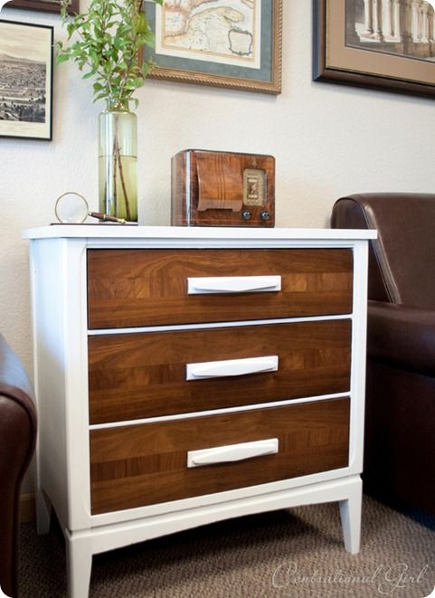 Take a rundown dresser, save the pretty wood look on the drawers but give it a new life with some white paint. The more I look at this, the more I like it.