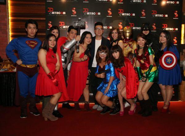 Jayacom staff all posed in their superhero costumes.