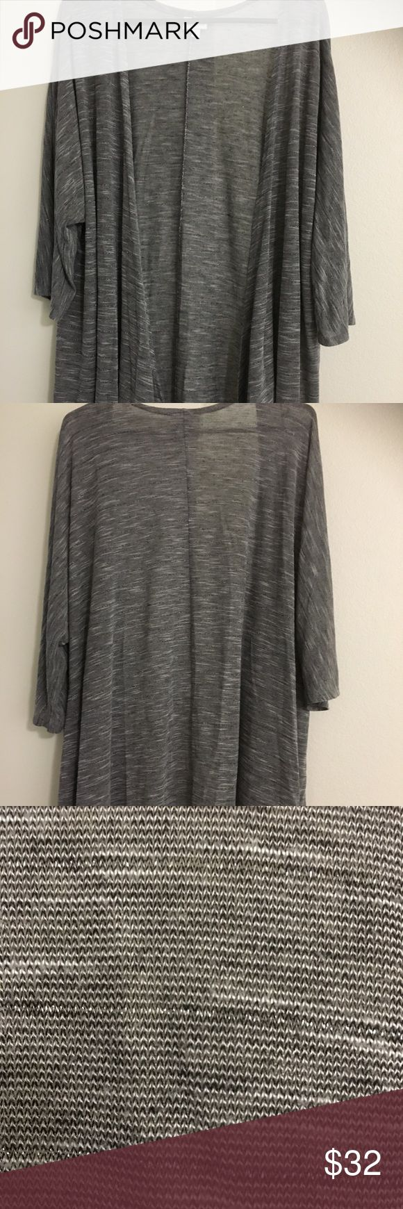LuLaRoe Lindsay Kimono L Gray/ Black/White LuLaRoe Lindsay Kimono Large fits sizes 18-22 Colors are Gray, Black and White. Lightweight material. Tag has been cut out. In Excellent condition! Very pretty! LuLaRoe Sweaters Cardigans