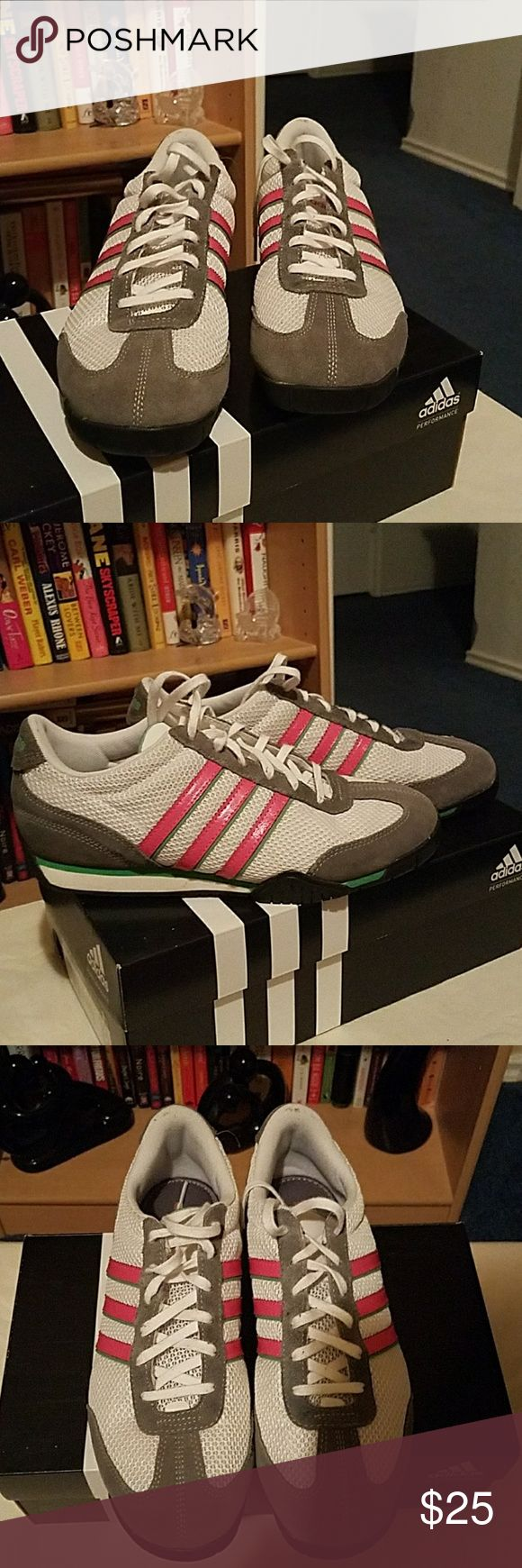 Women's Adidas Size 9 Tennis Shoes Women's Adidas Tennis Shoes.  Size 9. Colors include white, gray, pink and green trim. Slight ding on right shoe (see pic #6). Otherwise in great condition. Adidas Shoes Athletic Shoes