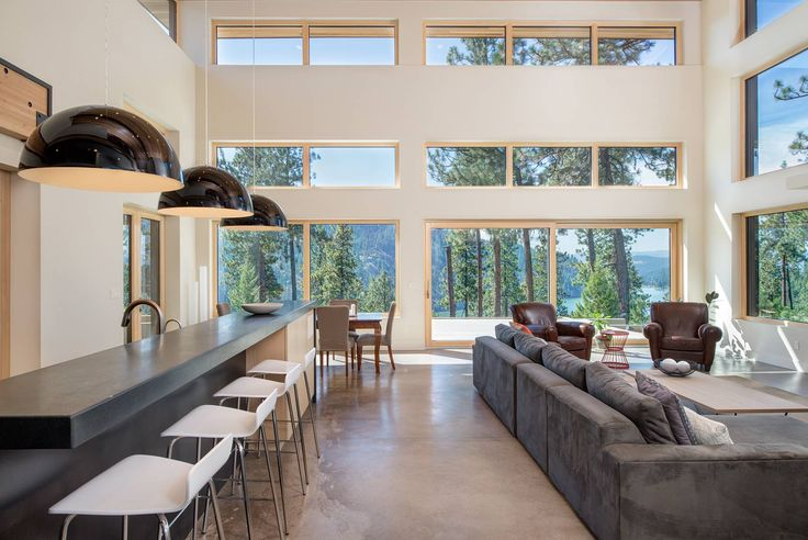 Modern Clerestory Windows provide daylight to this passive house open floor plan.