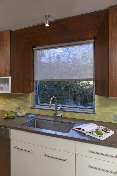 A linen roller shade supports the architects design in this modern Berkeley kitchen window with simplicity and elegance. (Design by Jerome Buttrick of Buttrick Wong Architects)