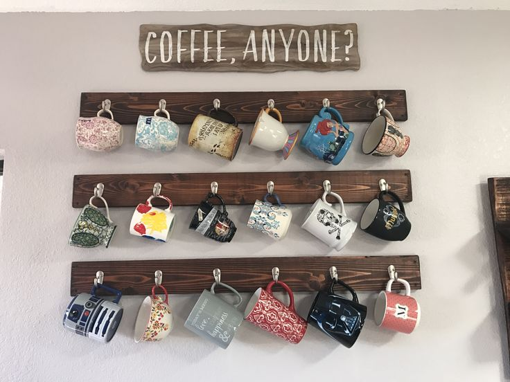 Coffee mug rack. Hanging coffee mugs on the walls.