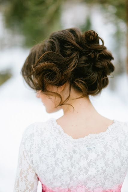 Soft curly updo.