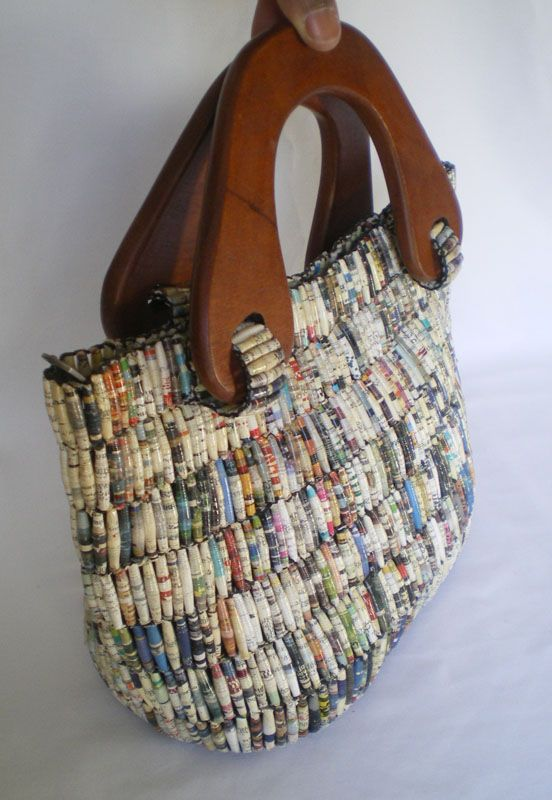 A beautifully crafted bag, handmade from beads rolled from recycled magazine paper