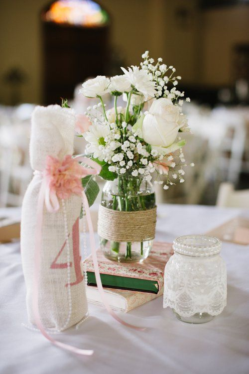 Large mason jars adorned with high quality hemp. These beautiful jars made the perfect flower vases for our vintage-inspired centerpieces!  Cash only and pick up only in OKC, OK.