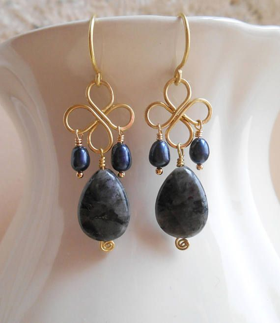 Statement-making in their dark palette and minimal design, these Ilse clover gemstone earrings have a playful, effortless bohemian vibe. I hand formed a quatrefoil wire frame out of gold filled wire and suspended at its bottom a lovely larvikite faceted almond briolette and two