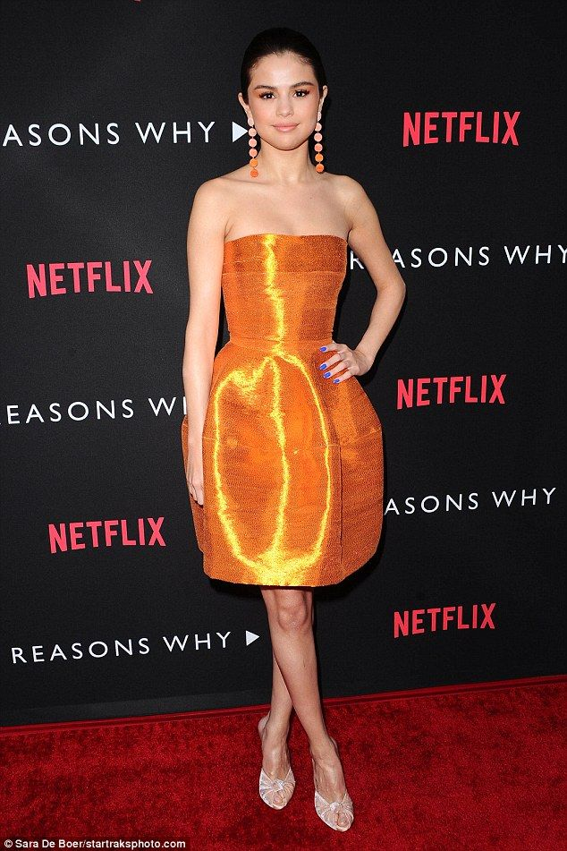 Golden girl: Selena Gomez was unmissable in tangerine as she stepped out on the red carpet...