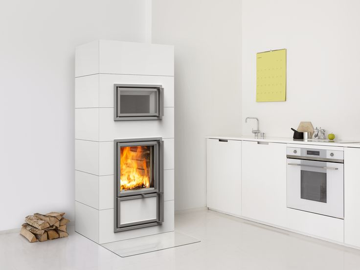 Mustio heat-retaining fireplace with a stew bakeoven, which can be placed on both sides of the fireplace. The full-sized and full-bodied tiles are of high-quality. Read more at www.tulikivi.fi