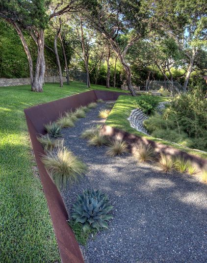 Love the way the corten retaining walls looks like they were cut out of the earth. Contemporary landscape by D-CRAIN Design and Construction