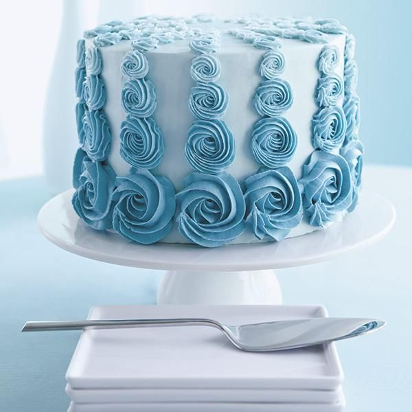 Teal Rosette Ombre Cake - Different-sized rosettes in shades of teal create an amazing ombre effect on this celebration cake. Sign up for The Wilton Method of Cake Decorating Course 1 to learn how to pipe rosettes and other amazing decorating techniques.