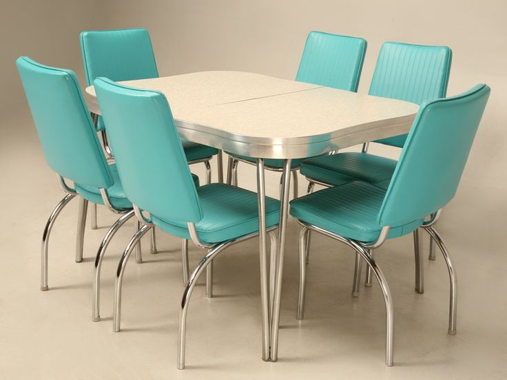 Take a leap back in time with this chrome, brushed aluminium, vinyl and formica retro dinette set.