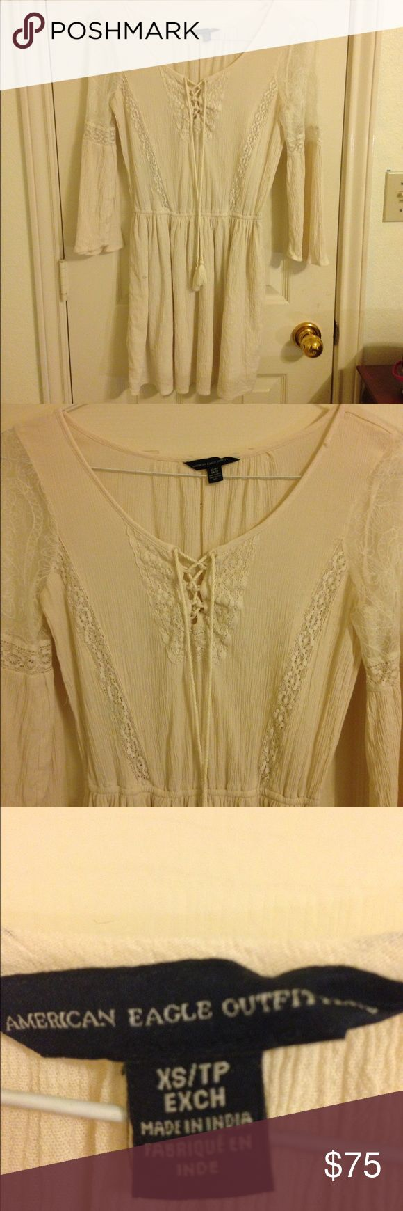 American Eagle Boho Long Sleeve Dress American Eagle Outfitters  New and never worn! Long sleeve dress Super cute boho Middle ties up Lace on the sleeves Cream and beige Perfect for fall and winter with boots! American Eagle Outfitters Dresses Long Sleeve