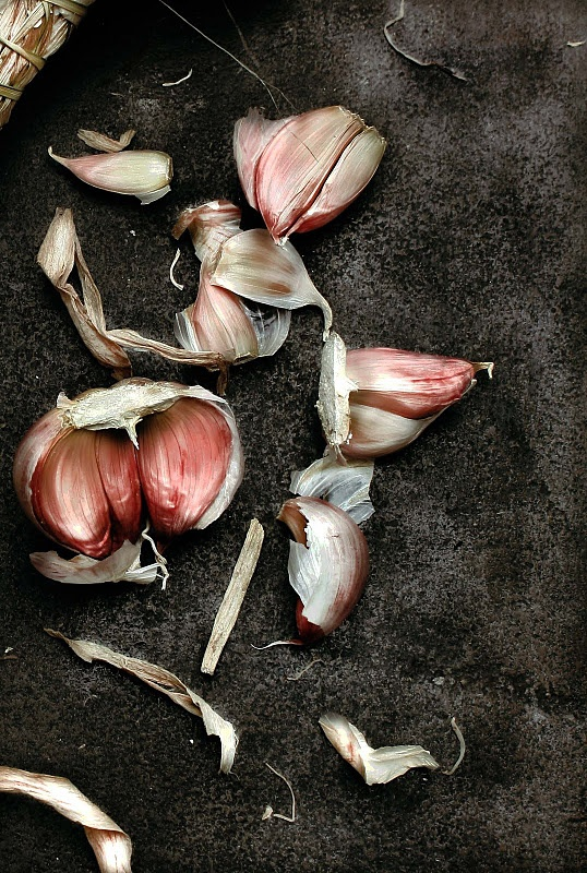 Pink garlic. Beautiful against the dark background. Love pink and grey together.