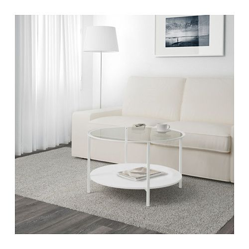 I would do something more open/ transparent for the coffee table to lighten up the room and make it feel bigger. There is also a skinny/ longer rectangular option too.
