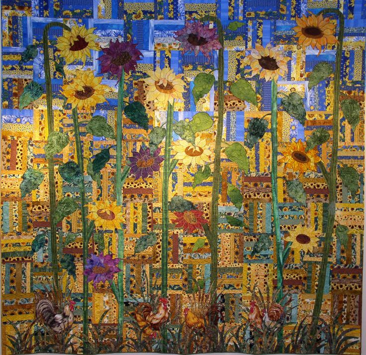 Sunflower quilt. I like it!! Looks like a rail fence background, which would be beautiful by itself.
