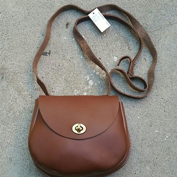 American apparel crossbody leather purse NWT American apparel brown LEATHER crossbody purse.. it's so beautiful and a classic must have! Hardware is antique gold. In mint condition,  no defects.. Never been used, still has tag attached!  *no trades American apparel  Bags Crossbody Bags