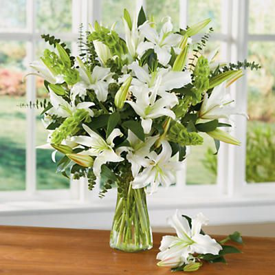 White Lily Bouquet - Our white lily bouquet is delivered fresh and blooming. An elegant bouquet of oriental lilies, Bells of Ireland and eucalyptus.