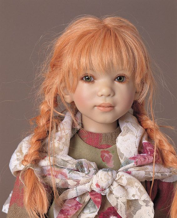 A repin of a doll by Annette Himstedt, a red-haired girl with braids and bangs …