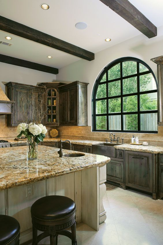 I love the beams, the giant window lets in a lot of light, the marble counter tops, an the barn cabinets my dream kitchen it's beautiful and rustic!!!