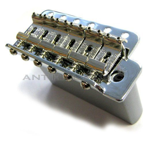 "Fender Mexico Vintage Strat Bridge Assemblies (005-4619-000) by Fender. $29.50. Fender tremolo bridge for MIM Classic Series Strats and Pre-2006 Highway One StratsThis Fender vintage style bridge assembly is for Mexican Vintage Stratocaster and pre-2006 Highway One models. This bridge comes complete with saddles and tremolo block. FeaturesString Spacing: 2-3/16""Mounting Hole Spacing: 2-7/32""Six screw mountChrome platingFender Part Number: 005-4619-000Does not include mounting ..."