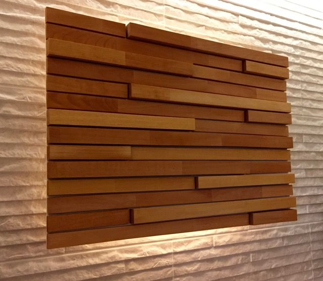 Pinterest inspired me to make this split face wooden wall art for my bathroom wall. I cut up lengths of beech wood kitchen worktop and attached them with a small gap between each piece to a thin sheet of plywood which I'd painted cream. I then mounted it just slightly away from the wall with some LED lighting strip to glow from behind.