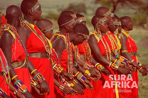 A group of Maasai women dancing with a beautiful and striking red ethnic clothing. #SuraAfrika luxury travels everywhere. #luxurysafaricamps #explorers #safari #love #Africa