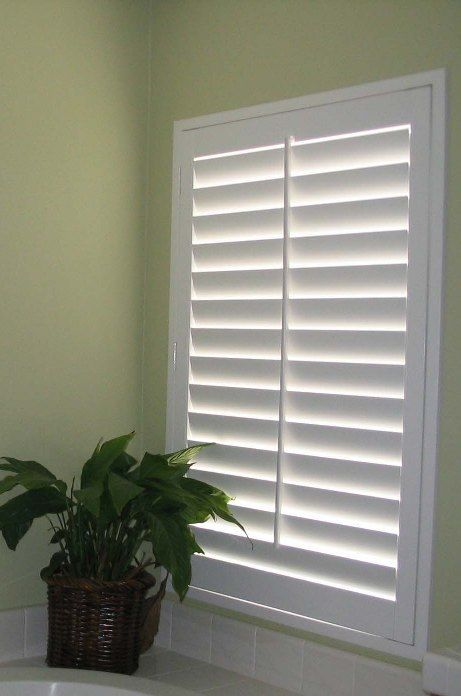 Fake basement window. Use LED lights behind louvered shutters and create that illusion of a window.