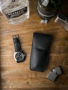 """Bas and Lokes pebbled black """"Kingsford"""" handcrafted leather watch pouch. Next to it is a handsome Lum-Tec paired with our black """"Kingsman"""" leather watch strap. Pouch and strap are both available at www.basandlokes.com"""