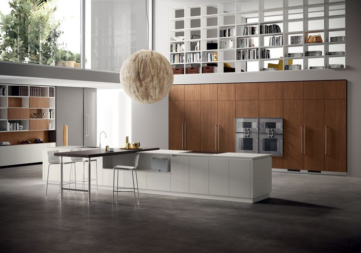 Compositions affording generous volumes, where the undisputed stars of the show are the materials: Tussah Walnut with its elegant vertical grain for the large cabinets, Malé White Fenix NTM for the island worktop and base units, and slatted Nabuk Oak for the breakfast bench top, with the new adjustable Slender support.
