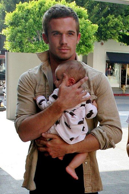 Cam Gigandet. Even with the baby he's adorable. Did you know he has a black belt in the Israeli martial art of Krav Maga?