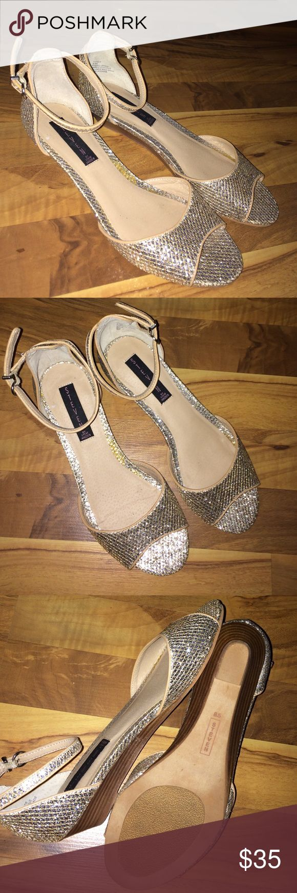 """Gold strappy low wedge sandals Super pretty and feminine gold strappy sandals with low wedge by STEVEN by Steve Madden. Great used condition. Size 8.5. 1.5"""" wedge Steven by Steve Madden Shoes Sandals"""