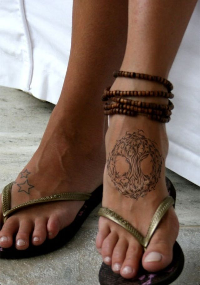 Foot tattoo - I love the tree of life tattoo.  I like the placement of the tattoo, but different design.