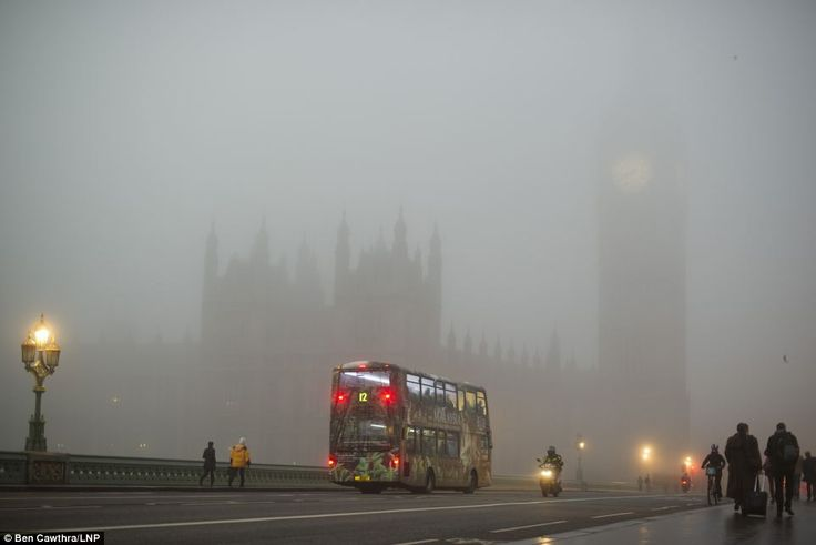 Veil of fog: A view from Westminster Bridge showing The Houses of Parliament in Westminster shrouded in fog early morning in central London, 11.12.13