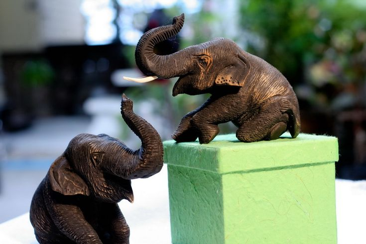Joyful elephants, hand-carved by Uncle Daeng, who has worked with wood since he was a boy, and uses naturally fallen wood for his carvings. www.familytree-huahin.com