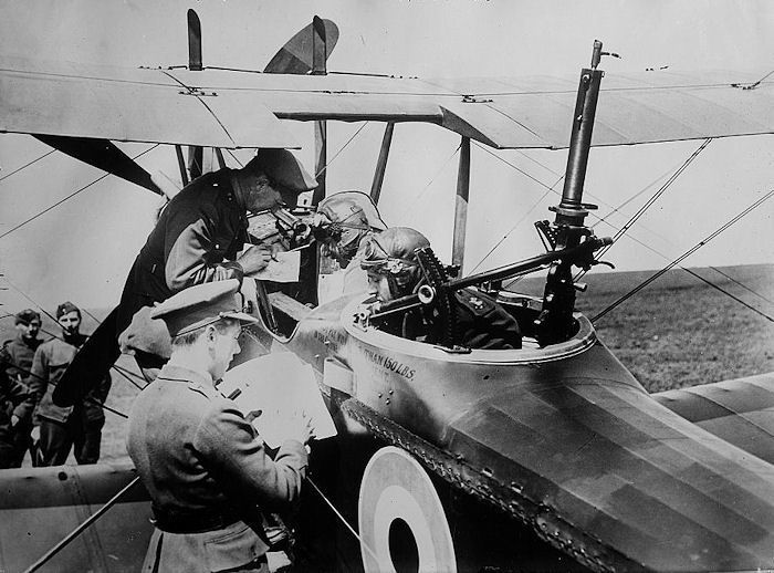 - 1916 - A last minute briefing for a British fighter crew before takeoff. The machine-gun mount in the rear could rotate in any direction.