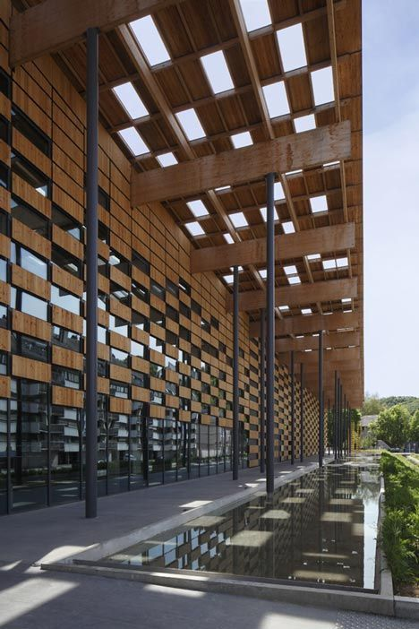 An art and culture centre with a chequered timber facade by Kengo Kuma.