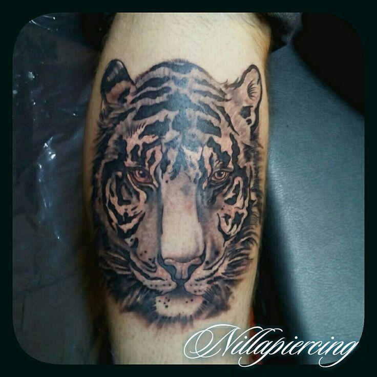 Tiger head By Nilla Piercing  #tatuaggio #tattoo #ink #tattoos #tatuaggi #inked #instatattoo #tattooed #tattooartist #tattooart #picoftheday #tigre #tiger #tatuaggiotigre #tigertattoos #blackandgray #tatuatrice #tatuaggiroma #tatuaggiopolpaccio #blackandwhite #strength